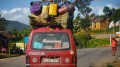 MADAGASCAR- DECEMBER 23, 2013. Overloaded bus moves on the aspha