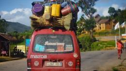 MADAGASCAR- DECEMBER 23, 2013. Overloaded bus moves on the aspha